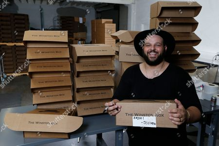 """Co-owner Daniel Franzese poses for a photo at """"The Winston Box"""" showroom in Gardena, Calif. The Winston Box is a monthly subscription box that designs and makes its own clothes for big guys. More online retailers are chasing after plus-sized men, selling big sizes of slim-cut jeans, faux leather jackets and other trendy clothing that can be hard to find at the local big and tall store. Franzese is also an actor, he was in in Tina Fey's 2004 feature film """"Mean Girls"""