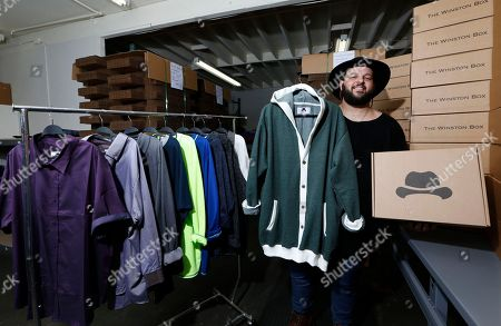 """Co-owner Daniel Franzese poses for a photo at """"The Winston Box"""" in the showroom in Gardena, Calif. The Winston Box is a monthly subscription box that designs and makes its own clothes for big guys. More online retailers are chasing after plus-sized men, selling big sizes of slim-cut jeans, faux leather jackets and other trendy clothing that can be hard to find at the local big and tall store. Franzese is also an actor, and was in """"Mean Girls"""