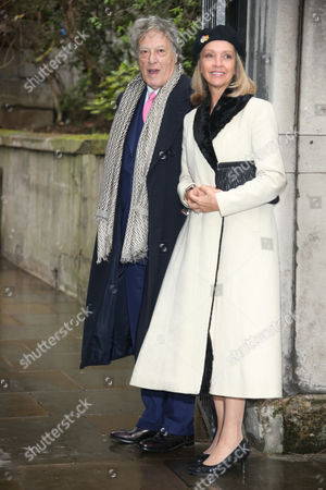 Tom Stoppard, left, and Sabrina Guinness arrive at St Bride's Church for the celebration ceremony of the wedding of Rupert Murdoch and Jerry Hall in London