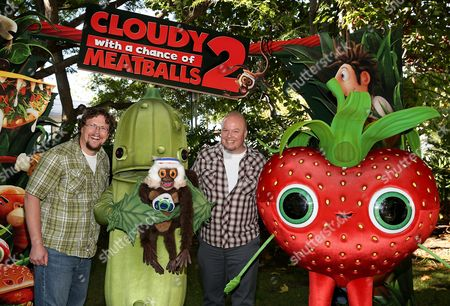 """From left, Directors Kris Pearn and Cody Cameron pose characters during a press day event for the movie """"Cloudy With A Chance Of Meatballs 2"""" held at Sony Pictures Animation, in Culver City, California"""
