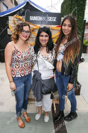 Tiffany Patterson, from left, Rachel Ontiveros and Valerie Cruz wait in line to play Tom Clancy's Rainbow Six Siege at the Ubisoft event during Comic-Con, in San Diego, Calif