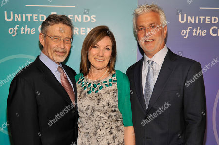 Honorees Wendy Smith Meyer, Ph.D, center, and Rob Friedman, right, pose with her husband Barry Meyer, Chairman of Warner Bros. Entertainment, at the United Friends of the Children Brass Ring Awards Dinner at the Beverly Hilton Hotel on in Beverly Hills, Calif