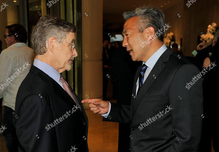 Barry Meyer, left, Chairman of Warner Bros. Entertainment, mingles with Kevin Tsujihara, Chief Executive Officer of Warner Bros., at the United Friends of the Children Brass Ring Awards Dinner at the Beverly Hilton Hotel on in Beverly Hills, Calif