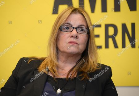 Amnesty International USA's Board Chair Ann Burroughs participates in an Amnesty International Pussy Riot press conference on in New York
