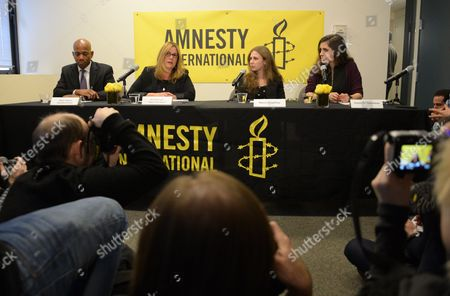 Stock Image of Executive Director of Amnesty USA Steven Hawkins, Board Chair Ann Burroughs, Maria Alekhina and Nadezhda Tolokonnikova participates in an Amnesty International Pussy Riot press conference on in New York