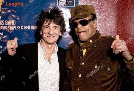 Stock Image of British musician Ronnie Wood, centre left, poses with U.S singer/songwriter Bobby Womack before presenting him with the 'Bluesfest Lifetime Achievement Award' for Services To Soul', at the Royal Albert Hall in west London