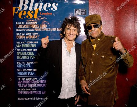British musician Ronnie Wood, centre, poses with U.S singer/songwriter Bobby Womack before presenting him with the 'Bluesfest Lifetime Achievement Award' for Services To Soul', at the Royal Albert Hall in west London