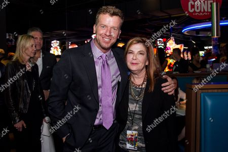 """McG, left, and Terry Press arrive at the Los Angeles Fan Screening of """"THE DUFF"""", in Los Angeles"""