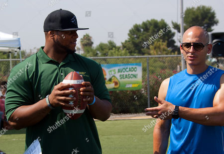 Pro football star Ndamukong Suh, a Famous Fan of SUBWAY Restaurants, and trainer to the stars Harley Pasternak speak with participants during an open workout with fans at the SUBWAY Superfood Training Camp on in Los Angeles, CA. SUBWAY, which introduced superfoods avocado and spinach to its national menu this summer, is the Official Training Restaurant of Suh and Athletes Everywhere