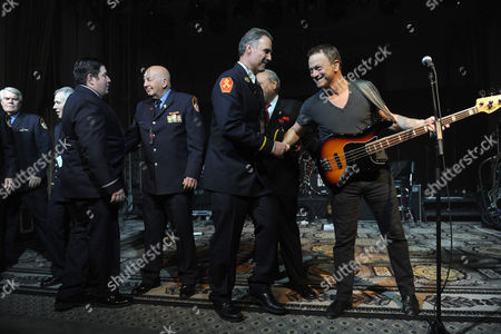 Stock Image of Actor Gary Sinise, right, and the Lt. Dan Band honor New York first responders at the Josh Cellars concert benefiting the Gary Sinise Foundation, which supports first responders, veterans and their families, in New York. Josh Cellars, a California wine brand, along with Deutsch Family Wine and Spirits and their distributor partners raised $113,900 for the Gary Sinise Foundation this year