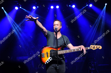 Stock Photo of Actor Gary Sinise and the Lt. Dan Band perform at the Josh Cellars concert to benefit the Gary Sinise Foundation, which supports first responders, veterans and their families, in New York. Josh Cellars, a California wine brand, along with Deutsch Family Wine and Spirits and their distributor partners raised $113,900 for the Gary Sinise Foundation this year