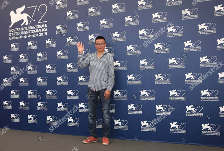 Director Zhao Liang poses during the photo call for the movie Beixi Moshuo (Behemoth) at the 72nd edition of the Venice Film Festival in Venice, Italy, . The 72nd edition of the festival runs until Sept. 12