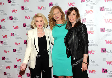 Host Joan Rivers, left, WE TV President and General Manager Kim Martin and television personality Melissa Rivers, right, attend the 2013 Matrix New York Women in Communications Awards at the Waldorf-Astoria Hotel on in New York