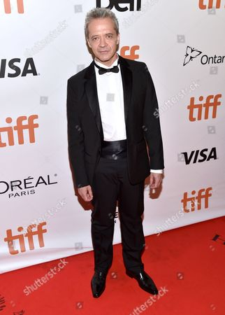 "Emmanuel Salinger arrives at the ""Planetarium"" premiere on day 3 of the Toronto International Film Festival at Roy Thomson Hall, in Toronto"