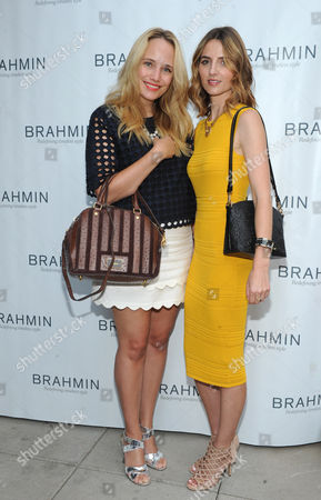 IMAGE DISTRIBUTED FOR BRAHMIN - Fashion bloggers Grace Atwood, left, and Jess Kirby attend the Brahmin handbag Fall 2014 Wearable Art Exhibit, in New York