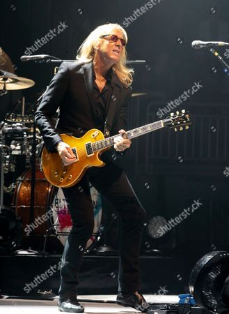 Davey Johnstone performs in concert with Elton John during his Wonderful Crazy Night Tour at The Giant Center, in Hershey, Pa