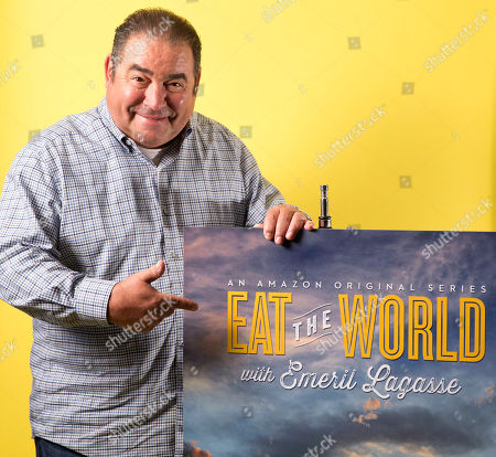 Emeril Lagasse poses for a portrait in promotion of his new television show â?˜Eat the World' in New York. The six-part Amazon Prime series is available for streaming Friday, Sept. 2