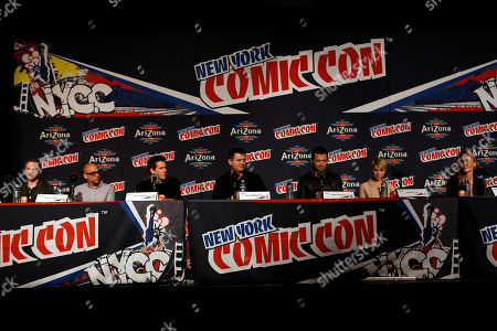 """From left, Shawn Ashmore, Marcos Siega, Kevin Bacon, Kevin Williamson, James Purefoy, Valorie Curry, and Connie Nielsen participate in FOX's """"The Following"""" panel during New York Comic Con, on at Javits Convention Center, in New York City, NY"""