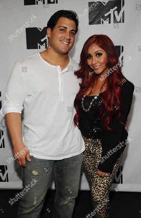 """Nicole """"Snooki"""" Polizzi and Jionni LaValle appear during MTV's Restore the Shore telethon at the MTV Times Square Studios on in New York"""