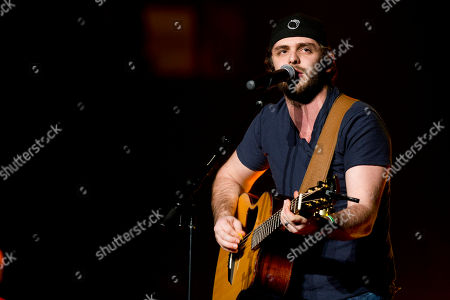 Thomas Rhett opens for Jason Aldean at Madison Square Garden, in New York. Growing up watching his father, Rhett Akins, on tour gave the 23-year-old Thomas Rhett some insight at a young age about how to deal with nerves and crowds