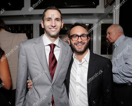 """Stock Picture of Producer Michael Benaroya and Writer/producer/director John Krokidas attend the party for Sony Pictures Classics Los Angeles Premiere of """"Kill Your Darlings"""" Presented by Blue Moon Brewing Company at Caufield's on in Los Angeles"""