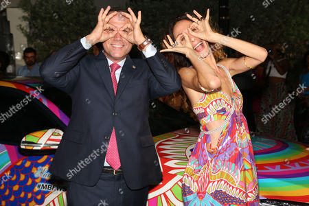 Stock Image of Mayor Philip Levine, City of Miami Beach and designer Mara Hoffman attend the 10th Anniversary of Mercedes-Benz Fashion Week Swim Opening Party on at the Raleigh Hotel in Miami Beach, Fl