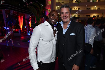 Director Antoine Fuqua, left, and Stuart Ford, CEO of IM Global, seen at the 2014 American Film Market (AFM) at the Loews Santa Monica Hotel on in Santa Monica, Calif