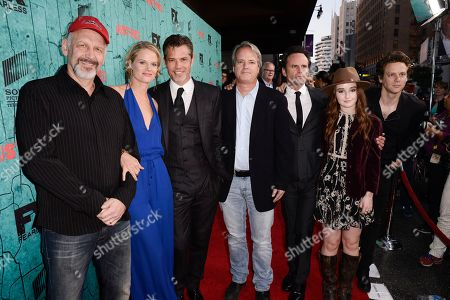 """From left to right, actor Nick Searcy, actress Joelle Carter, actor Timothy Olyphant, executive producer Graham Yost, actor Walton Goggins, actress Kaitlyn Dever, and actor Jacob Pitts attend the screening for the television series finale of FX's """"Justified"""" in Los Angeles on"""