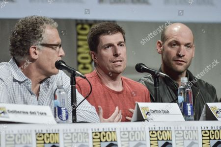 "From left, Carlton Cuse, Chuck Hogan, and Corey Stoll attend ""The Strain"" panel on day 4 of Comic-Con International, in San Diego"