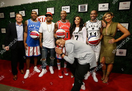 Pictured from left to right, Harlem Globetrotters CEO, Kurt Schneider, Thunder Law, rapper Maino, Smooth Staples, designer Angela Simmons, Cheese Chisholm, and entertainers Bridget Kelly and Mack Wilds, foreground, on the red-carpet during the Harlem Globetrotters/Angela Simmons show as part of New York Fashion Week, New York, N.Y