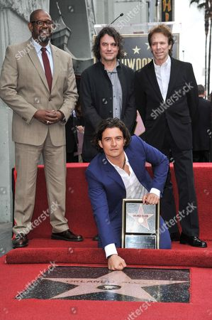 From left, Forest Whitaker, David Leveaux, Orlando Bloom, front, and Jerry Bruckheimer attend the ceremony to honor Bloom with a star on the Hollywood Walk of Fame, in Los Angeles