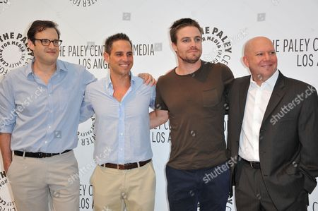 From left, Andrew Kreisberg, Greg Berlanti, Stephen Amell and Marc Guggenheim attend the PaleyFest Fall TV Preview Party for CW at The Paley Center for Media, in Beverly Hills, Calif