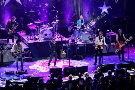 Top left, counter-clockwise, artists Warren Ham, Todd Lukather, Ringo Starr, Richard Page, Todd Rundgren and Gregg Bissonette perform at the Ryman Auditorium, in Nashville, Tenn