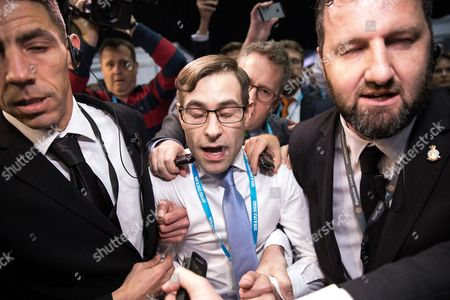 Stunt comedian Simon Brodkin (aka Lee Nelson) is ejected from the conference hall by security guards after handing Prime Minister Theresa May a P45 form during her keynote speech on the fourth and final day of the Conservative Party Conference Brodkin said Boris Johnson told him to do it.