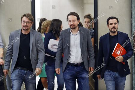 Secretary-General of Podemos party (We Can), Pablo Iglesias (C), federal coordinator of the United Left (IU), Alberto Garzon (R), and En Comu Podem's parliamentary spokesman, Xavier Domenech, arrive for a meeting with representatives of nationalist plitical groups PDeCAT, ERC and PNV called by Podemos to look for a solution for the current situation in Catalonia after the '1-O Referendum', at the Parliament's Lower Chamber in Madrid, Spain, 04 October 2017. Catalonian authorities consider declaring an unilateral independence from Spain after the 01 October Catalan independence referendum. A vast majority voted 'yes' to a Catalan independence in the referendum that had been banned by the Spanish Constitutional Court and saw national police and civil guards deployed in order to prevent the people from voting.
