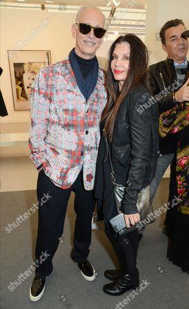 Stock Photo of John Waters and Loree Rodkin