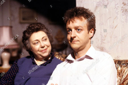 'Watching'   - Malcolm's mother Mrs Stoneway [Patsy Byrne] and Malcolm [Paul Brown].