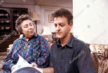 'Watching'   - Malcolm's mum Mrs Stoneway [Patsy Byrne] and Malcolm [Paul Brown].