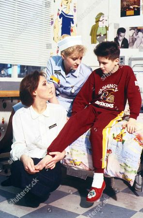 Stock Picture of 'Children's Ward'  TV - 1989 - Dr Charlotte Woods deals with a new patient, Darren Walsh [William Ash] with Diane Meadows [Janette Beverley] in attendance.