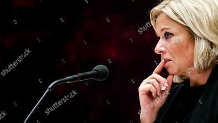 Stock Picture of A picture made available on 04 October 2017 shows Dutch Defence Minister Jeanine Hennis-Plasschaert looking on after she announced her resignation in the Dutch parliament De Tweede Kamer in The Hague, Netherlands, 03 October 2017 (issued 04 October 2017). Hennis-Plasschaert stepped down on 03 October after a report denounced 'serious shortcomings' over the deaths of ywo Dutch soldiers in Mali during an exeercise in 2016.
