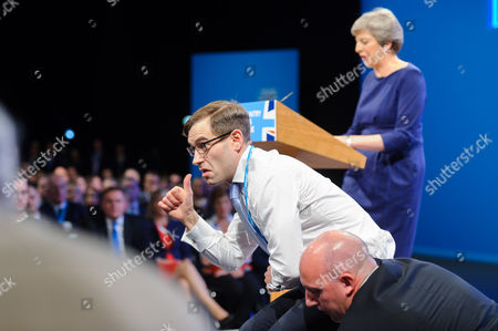 Protester Simon Brodkin aka Lee Nelson hands P45 to Prime Minister Theresa May