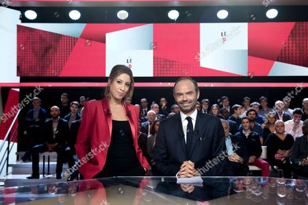 French journalist and host Lea Salame and French Prime Minister Edouard Philippe