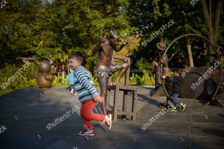 Children play around a monument that celebrates circus arts dedicated to the late Prince Rainier III of Monaco, during the unveiling in Bucharest, Romania, . Princess Stephanie of Monaco has unveiled a statue dedicated to her father the late Prince Rainier III, and a monument in the Romanian capital that celebrates circus arts