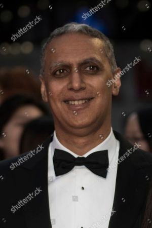 Nitin Sawhney poses for photographers upon arrival at the premiere of the film 'Breathe' showing as part of the BFI London Film Festival opening gala, in London