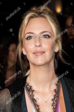Miranda Raison poses for photographers premiere of the film 'Breathe' showing as part of the BFI London Film Festival opening gala, in London