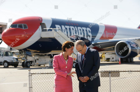 Gina Raimondo, Jonathan Kraft. Rhode Island Gov. Gina Raimondo, left, and Jonathan Kraft, president of the Kraft Group, right, speak with one another at the start of a news conference in front of the New England Patriots customized Boeing 767 passenger jet, behind, on the tarmac, at T.F. Green Airport in Warwick, R.I. The NFL football team are to fly in the aircraft, which is painted with the team's logo and red-white-and-blue colors, and includes the Pats' five Lombardi trophies painted on the tail, on their way to Florida where they are to play the Tampa Bay Buccaneers, Thursday, Oct. 5