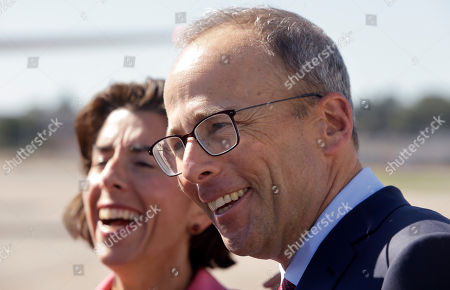 Gina Raimondo, Jonathan Kraft. Rhode Island Gov. Gina Raimondo, left, and Jonathan Kraft, president of the Kraft Group, right, smile while speaking with reporters during a presentation of the New England Patriots customized Boeing 767 passenger jet, not shown, at T.F. Green Airport, in Warwick, R.I. The NFL football team are to fly in the aircraft, which is painted with the team's logo and red-white-and-blue colors, and includes the Pats' five Lombardi trophies painted on the tail, on their way to Florida where they are to play the Tampa Bay Buccaneers, Thursday, Oct. 5