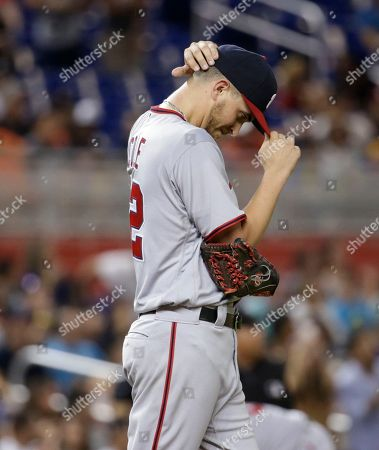 Washington Nationals starting pitcher A. J. Cole adjusts his cap during a baseball game against the Miami Marlins, in Miami