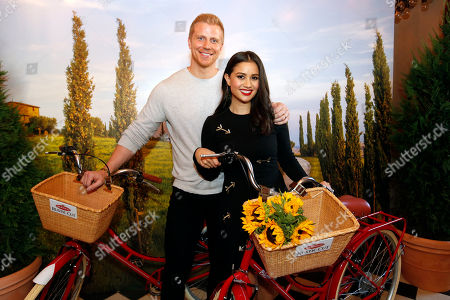 Sean Lowe, Catherine Lowe. Sean and Catherine Lowe take a photo in front of a Tuscan-inspired backdrop at Gramercy Terrace on in New York to celebrate the launch of the new Bertolli Rustic Cut Pasta Sauces. The new sauces are available in four varieties that have no artificial colors, no artificial flavors and no added sugar