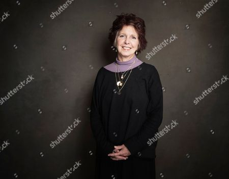 Stock Image of Deanna Walters poses for a portrait at Quaker Good Energy Lodge with GenArt and the Collective, during the Sundance Film Festival, on in Park City, Utah